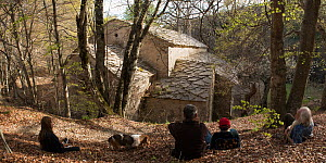 Family with dog relaxing during hike to Abbaye Notre-Dame de Lure, France, April. - Jean E. Roche