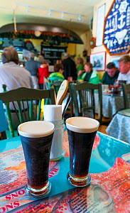 Two halves of Guinness in restaurant, Dingle Village, Dingle Peninsula, County Kerry, Ireland, Europe. September 2015.  -  Juan  Carlos Munoz