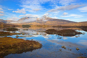 Clouds, mirror reflections and mist clearing Mountains on Loch nah Achlaise on Rannoch Moor in the Highlands, Scotland, UK. April 2011. - Peter  Lewis