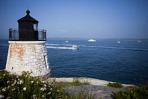 Castle Hill Lighthouse andMinor Offshore 31 leaves Newport Rhode Island, USA, August 2009.  -  Billy  Black