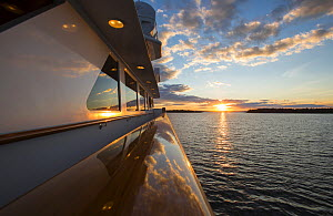 Sunset seen from the yacht Lady J near Butter Island, Maine, USA, August 2012.  -  Billy  Black