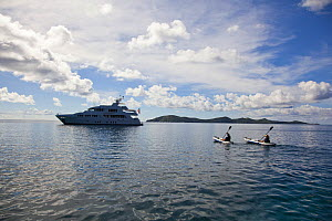Milk & Honey, 125-foot Palmer Johnson yacht and two kayakers, US Virgin Islands. December 2011.  -  Billy  Black