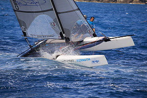 Catamaran heeling during sailors in St. Barths, West Indies, March 2012.  -  Billy  Black