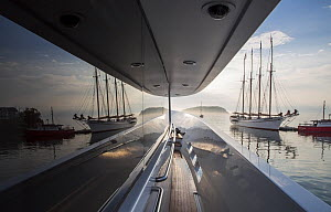 View of sailing boat reflected in window of yacht 'Trisara, 130' Westport' in Bar Harbor, Maine, USA, August 2013. - Billy  Black