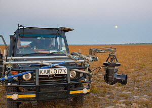 Cineflex on  4WD vehicle, camera rig. On location to film The Hunt. Liuwa National Park, Zambia. October 2013. - Huw Cordey