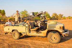 Producer Huw Cordey, and wildlife cameraman Jamie McPherson, on filming vehicle - with 4K gyro stabilised cineflex suspended from a jib arm. On Location to film BBC series 'The Hunt' South Luangwa Nat... - Huw Cordey