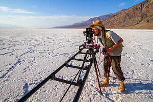 German Wildlife Cameraman, Rolf Steinmann, setting up a tracking time-lapse in Badwater Basin, Death Valley, California, May 2011 on location for Discovery North America series - Huw Cordey