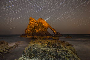 Bowfiddle rock arch with star trails in sky, Portknockie, Moray, Scotland, UK, August 2015.  -  SCOTLAND: The Big Picture