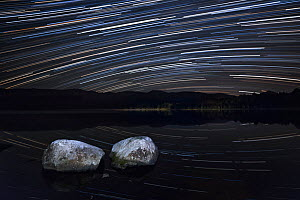 Night sky over Loch Morlich with star trails, Cairngorms National Park, Cairngorms, Scotland, UK, September 2015.  -  SCOTLAND: The Big Picture