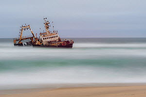 Wrecked ship with cormorant colony, on Namibia's skeleton coast, Dorob National Park, Namibia. July 2013. - Jack Dykinga