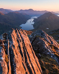 Rock formations on Bhudhie Bheinn lit by the setting sun. Knoydart, Scotland, UK, June 2016.  -  SCOTLAND: The Big Picture