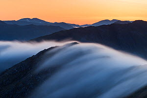 Long exposure of mist flowing over Bhudhie Bheinn at dawn with the mountains of Kintail on the horizon. Knoydart, Scotland, UK, June 2016.  -  SCOTLAND: The Big Picture