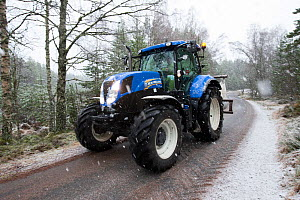 Tractor transporting bags of moss brash to distribute on bare peat as part of peatland restoration project, Inshriach, Glenfeshie, Cairngorms National Park, Scotland, UK, January 2015.  -  SCOTLAND: The Big Picture