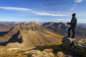 Hiker looking out from Sgurr Mor towards Torridonian mountains, Wester Ross, Scotland, UK, October 2015. - SCOTLAND: The Big Picture