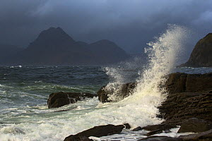Wave breaking over rocks in stormy weather, Elgol with view of The Cuillin, Isle of Skye, Scotland, UK, October 2013.  -  SCOTLAND: The Big Picture
