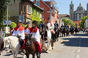 Children and adults riding horses at the Blutritt (the right of blood) the largest European procession with about 3, 000 riders, Weingarten, Baden-Wurtemberg, Germany. May 2016. - Kristel  Richard