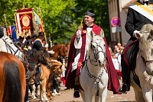 Priest on horseback at the Blutritt (the right of blood) the largest European procession with about 3 000 riders, Weingarten, Baden-Wurtemberg, Germany. May 2016. - Kristel  Richard