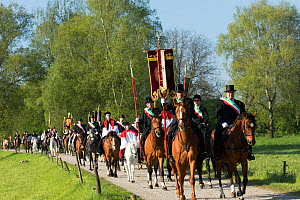 Men and clergy riding horses during the Blutritt (the right of blood)  the largest European procession with about 3,000 riders, Weingarten, Baden-Wurtemberg, Germany. May 2016. - Kristel  Richard