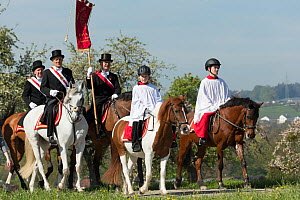 Altar servers riding horses during the Blutritt (the right of blood)  the largest European procession of horses with about 3,000 riders, Weingarten, Baden-Wurtemberg, Germany. May 2016. - Kristel  Richard