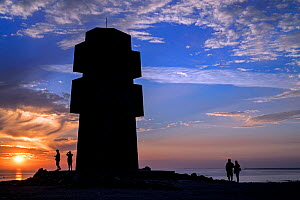 Tourists visiting the Monument to the Bretons of Free France / Cross of Pen Hir at sunset, Pointe de Pen-Hir, Brittany, France, September 2015  -  Philippe Clement