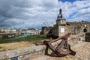 Old anchor and belfry at the entrance gate to the medieval Ville Close at Concarneau, Finistere, Brittany, France, September 2015 - Philippe Clement