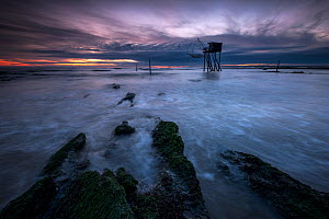 Traditional carrelet fishing hut at dusk with lift net on the beach at Saint-Michel-Chef-Chef, Loire-Atlantique, France September 2016  -  Benjamin  Barthelemy