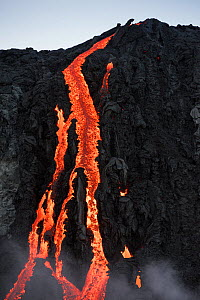 Hot lava from the 61G flow, emanating from Pu'u O'o on Kilauea Volcano, flows over seacliffs into the ocean on the first week of its ocean entry at Kamokuna, in Hawaii Volcanoes National Park, Kalapan...  -  Doug Perrine
