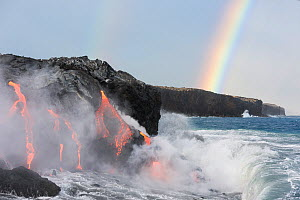 Hot lava from the 61G flow, emanating from Pu'u O'o on Kilauea Volcano, flows through lava tubes into the ocean in front of a double rainbow at the Kamokuna ocean entry in Hawaii Volcanoes National Pa...  -  Doug Perrine