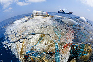 A tangle of fishing nets, lines, hooks and other garbage found floating in the Indian Ocean. There was a small community of fish associated with this trash, but also fish that had been entangled and k...  -  Tony Wu