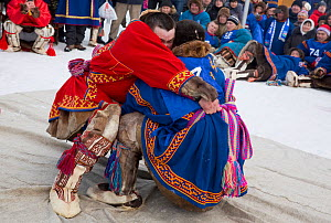 Two young Nenets men compete in a wrestling competition during the reindeer herders' festival in Nadym. Yamal, Western Siberia, Russia - Bryan and Cherry Alexander