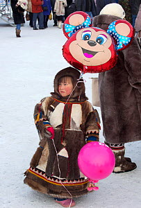 Young Nenets boy holding balloons at the reindeer herders' festival in Nadym. Yamal, Western Siberia, Russia - Bryan and Cherry Alexander