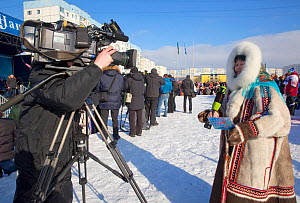 Torgina Romanova, a local Nenets TV reporter, covering the reindeer herders' festival in Nadym. Yamal, Western Siberia, Russia - Bryan and Cherry Alexander