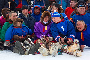 Nenets men watching a wrestling competition during the reindeer herders' festival in Nadym. Yamal, Western Siberia, Russia - Bryan and Cherry Alexander