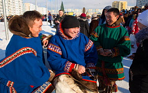 Young Nenets men in traditional clothes at the reindeer herders' festival in Nadym. Yamal, Western Siberia, Russia - Bryan and Cherry Alexander
