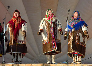 Three Mansi women (left to right) Galina Larionova, Valentina Georgimova and Tamara Kalinikova, performing traditional Mansi songs at a reindeer herders' festival in Saranpaul. Khanty-Mansiysk, Wester... - Bryan and Cherry Alexander