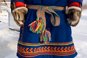 Nenets man's traditional decorated malitsa (reindeer skin parka). Yamal, Western Siberia, Russia  -  Bryan and Cherry Alexander