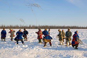 Nenets men competing in a lassoing competition at a reindeer herders festival in the Yamal. Western Siberia, Russia - Bryan and Cherry Alexander