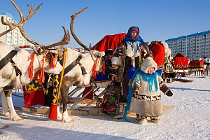 Khanty woman and her children arriving by reindeer sled at a festival in Nadym. Yamal, Northwest Siberia, Russia  -  Bryan and Cherry Alexander