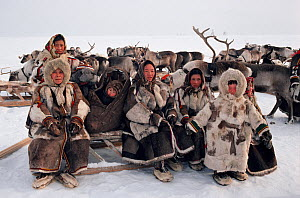 Nenets women and children in traditional reindeer skin clothing at a festival on the tundra. Yamal, Siberia, Russia.  -  Bryan and Cherry Alexander