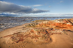 Sandstone rocks eroded by tidal action at high tide near Hilbre Point,  Hilbre Island and North Wales in the background at high tide Dee Estuary Hoylake, Wirral UK November. - Alan  Williams