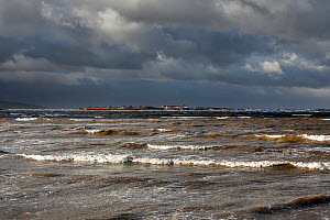 Hilbre Island viewed at high tide with gathering storm clouds from  Hilbre Point at the mouth of the Dee Estuary Wirral UK January 2016. - Alan  Williams
