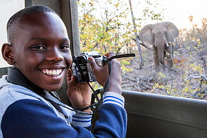 Vuthlare Nyathi, Wild Shots Outreach student from Mabine Primary School, photographs an inquisitive African elephant (Loxodonta africana) on her first ever game drive in the Greater Kruger National Pa...  -  Wild Shots Outreach