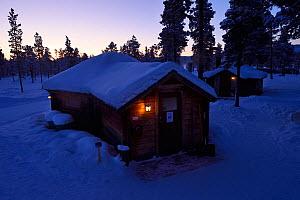 The Reindeer Lodge at dusk in mid winter colours in -39 degrees C, run by Nutti Sami Siida, near the Icehotel, in Jukkasjarvi, Lapland, Laponia, Norrbotten county, Sweden  -  Staffan Widstrand