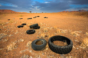 Pollution in the Namib Desert, due to illegal dumping of old tires. Namibia. - Christophe Courteau
