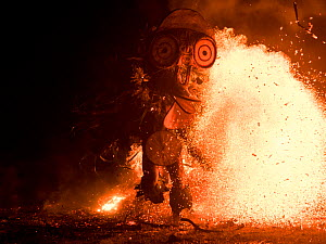 Baining men in traditional fire dance ceremony. Men enter a trance like state and dance around the fire in animal masks to contact the spirit world. Papua New Guinea, March 2017.  -  Roy Mangersnes