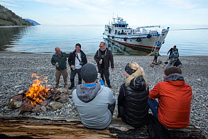 Tourists on land excursion to the shore from the liveaboard dive boat 'Valeria', Lake Baikal, Siberia, Russia. - Franco  Banfi