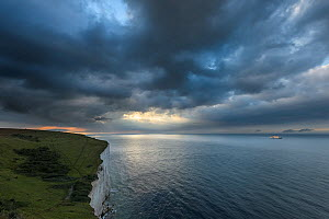 Receding storm over white cliffs of Dover with cross-channel ferry. Kent, UK. July - Terry  Whittaker