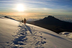 Hiker looking out towards  Mawenzi Peak from Mount Kilimanjaro at sunrise, Tanzania, May 2008 - Jen Guyton