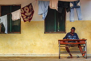 Boy studying  in front of a dormitory in Mossuril, northern Mozambique. June 2011  -  Jen Guyton