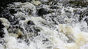 Water flowing over rocks in a river, Highlands, Scotland, UK, September. - Philippe Clement